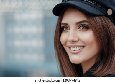 woman summer portrait. shining smiling girl outdoors. fashion and beauty. young girl in autumn colors posing near white wall smiling. Autumn woman. Brown hair and eyes. Warm autumn. Warm spring