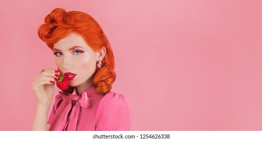 Woman with summer strawberry. Yogurt color panorama. Summer trend. Redhead lady with red nails and lips on pastel background. Minimal trend. Spring strawberry yogurt color panorama. Bright manicure
