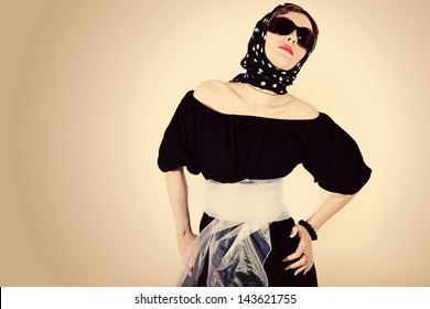 Woman in sun glasses on a white background. retro style