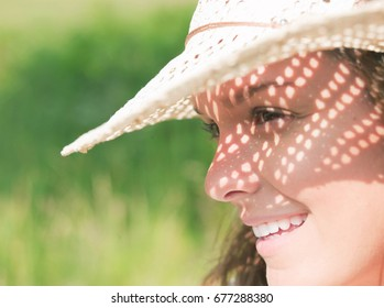 Woman in sun hat in sunshine