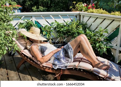 woman sunbathes on a balcony