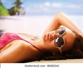 woman sunbathing in beach