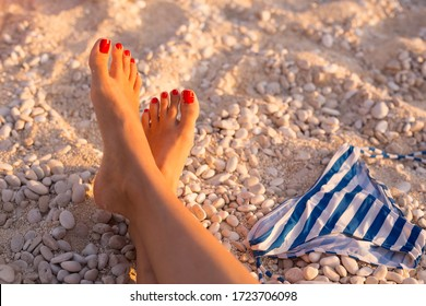 Woman sunbathing her feet on a beautiful beach