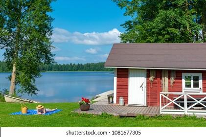Woman sunbathing at lake