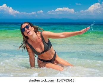 woman sunbathing on the beach summer travel holidays