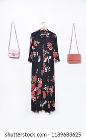 Woman Sundress Clothes with Seamless pattern with flowers. Sundress,two handbag on hanging