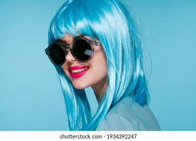 woman in sunglasses and blue wig makeup model shirt
