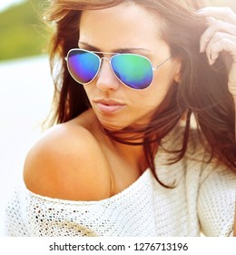 Woman in sunglasses - close up