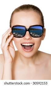 Woman in sunglasses and sea reflection on white