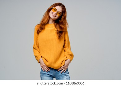woman in sunglasses and yellow sweater