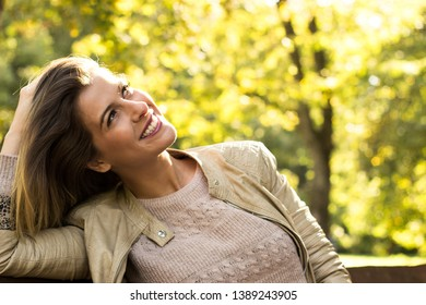 Woman sunny nature portrait, looking at view