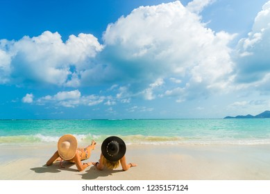 Woman suntanning - Winter holidays at the tropical beach