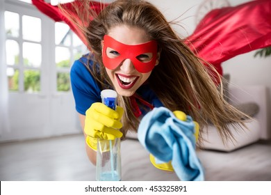 Woman superhero flying through the room with a mop
