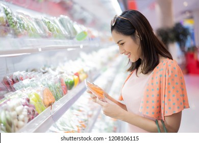 The woman is in the supermarket. Are shopping for food
