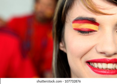 Woman supporting the Spanish football team