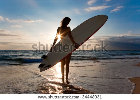 woman with surfboard and shinning sun light