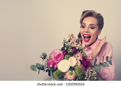 Woman surprised with bunch of flowers, funny emotional expression
