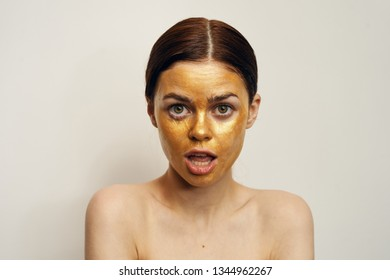 woman surprised in a cosmetic mask