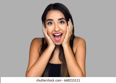 Woman surprised with joy happiness ecstatic in disbelief emotional expression thrilled