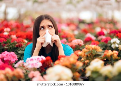 Woman Surrounded by Flowers Suffering from Allergies. Blooming decorative plants acting as allergens in spring time