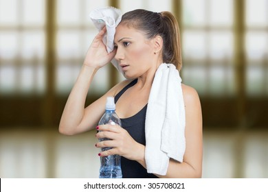 Woman sweating with a bottle of water