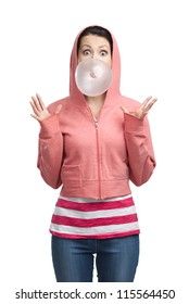 Woman in sweatshirt blows out pink bubble gum, isolated on white