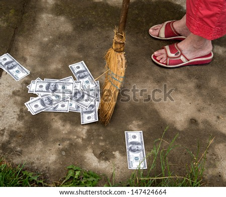 Woman sweeping dollars.