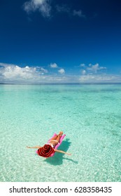 Woman swim and relax on inflatable mattress in the sea. Happy island lifestyle. White sand, crystal-blue sea of tropical beach. Vacation at Paradise. Ocean beach relax, travel to Maldives islands