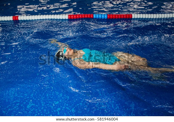woman swimmer swims in a swimming pool, water sports