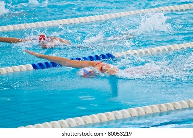 woman swimming during a competition