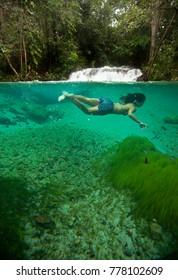 Woman swimming at Formiga Waterfall, at Jalapao Natural Park. Mateiros city, Tocantins, Brazil. 20/10/2015