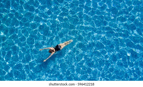 A woman swimming in the pool