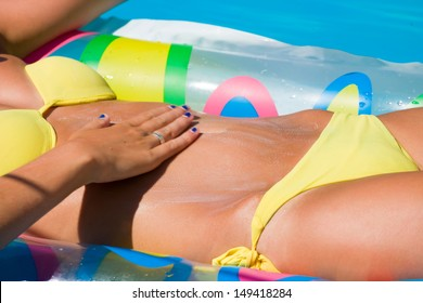 Woman in the swimming pool putting solar cream  Motion blur