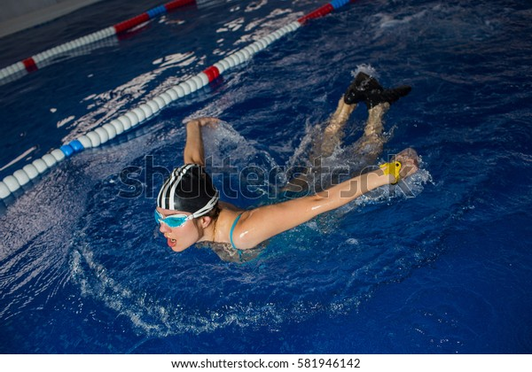 woman swimming using sports technique - butterfly. Workout swimmer in the pool