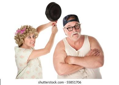 Woman swinging frying pan toward the head of an unsuspecting man