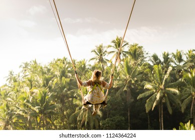 Woman swinging in the jungle, Bali