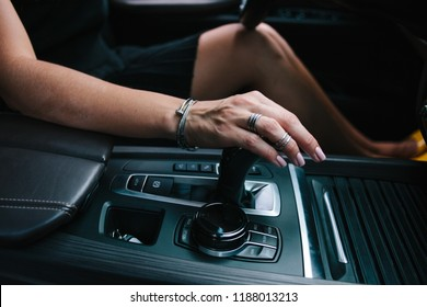 woman switches the automatic transmission's close-up. Close-up of the driver's adm includes mode Drive on the gear lever automatic transmission of the car interior parts