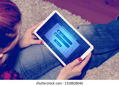 A Woman, Tablet PC and Login Page
