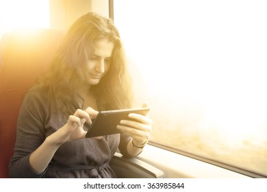 woman with tablet pc on a train ride