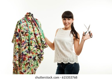 the woman the tailor about a mannequin on a white background