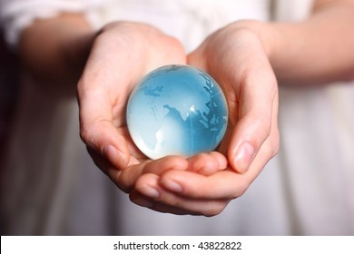 Woman take care about globe glass earth