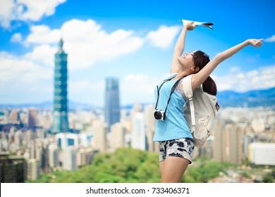 woman take map and feel free in the taipei