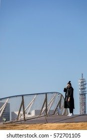 Woman take a photo with 35mm camera. Shoot with beautiful morning light and clear blue sky.