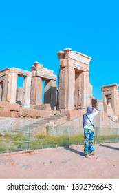 A Woman take photo  the ruins of the ancient city - The palace of Xerxes at Persepolis - Persepolis, an ancient capital of Persian Empire - IRAN