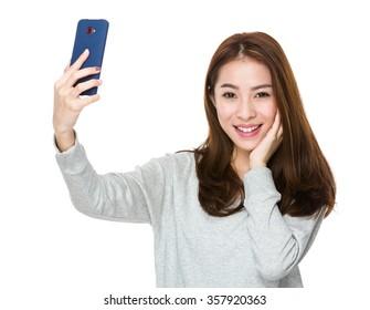 Woman take selfie by mobile phone