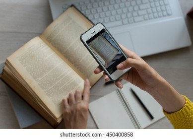 woman take shot of book page