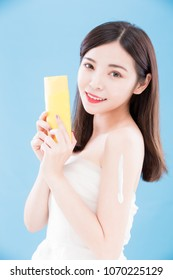 woman take sun cream with sun protection concept on the blue backgorund