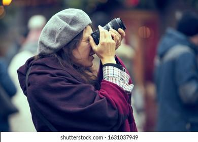 woman takes a photo by camera 10-09-2019 Riga, Latvia.