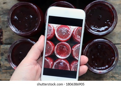 Woman takes picture of homemade plum jam