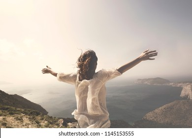 woman taking a breath in front of a spectacular view